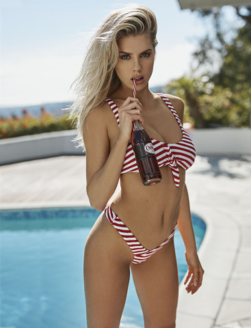 GUESS?, INC. ANNOUNCES PARTNERSHIP WITH CHARLOTTE MCKINNEY FOR SS19 SWIMWEAR CAPSULE (Photo: Busines ...