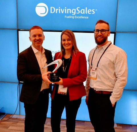 DealerSocket's Julie Lozano accepts the award from DrivingSales (Photo: Business Wire)
