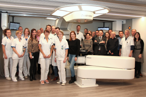 Team members from ZON-PTC and Mevion gather to celebrate the first patient treatment. (Photo: Business Wire)