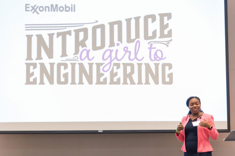 Middle-school students honed their problem-solving skills with ExxonMobil volunteers as part of the company's annual Introduce a Girl to Engineering Day. The event is designed to showcase the fun and creativity in everyday challenges and to encourage more girls to pursue engineering careers. ExxonMobil engineer, Kani Udoh, welcomes students and talks about the exciting opportunities an engineering career can bring. (Photo: Business Wire)