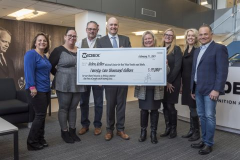 Widex USA recently donated $22,000 to the Helen Keller National Center (HKNC) as part of the company's ongoing mission to improve the lives of people with hearing loss. Surrounded by colleagues from both organizations, Widex USA President Jeff Geigel (center) presents HKNC Executive Director Susan Ruzenski with a check at Widex USA's Hauppauge, NY, headquarters. (Photo: Business Wire)
