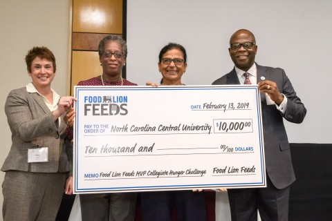 Food Lion President Meg Ham (left), N.C. Central University Chancellor Dr. Johnson O. Akinleye, with staff from North Carolina Central University. (Photo: Business Wire)