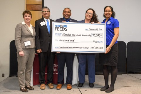 Food Lion President Meg Ham along with representatives from Elizabeth City State University. (Photo: Business Wire)