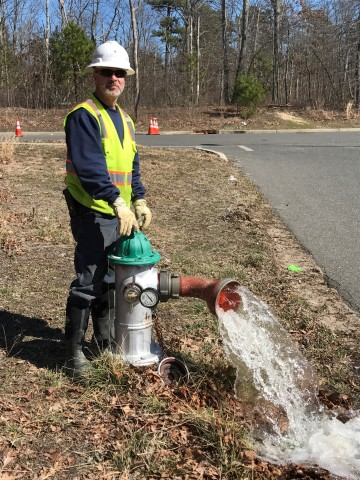 New Jersey American Water's Joseph Green flushing a hydrant in the company's Lakewood service area.  ...