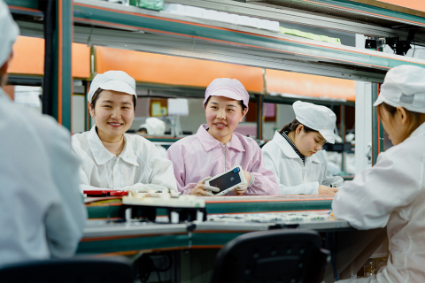 Line operators at an iPhone production facility in China awarded the Green Factory designation. (Pho ...