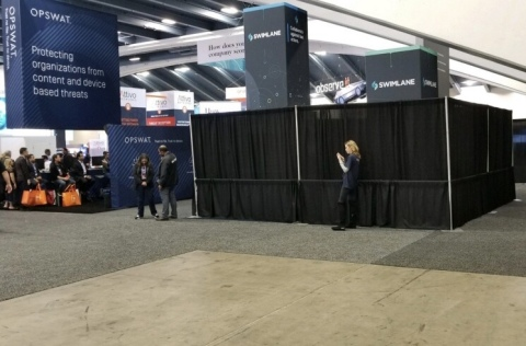 RSAC staff covers Swimlane booth. (Photo: Business Wire)