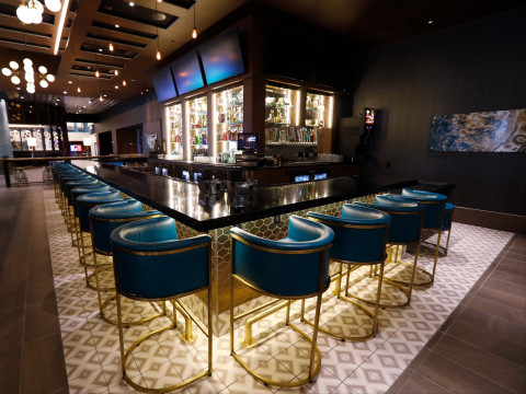 CUT by Cinemark features a full-service bar offering more than 20 popular beers, including local draft IPAs, as well as an impressive wine selection, four specialty martinis and signature cocktails. (Photo: Business Wire)
