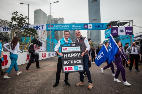 ABB CEO Ulrich Spiesshofer congratulates Alejandro Agag, chairman/ founder of the ABB FIA Formula E Championship, on the grid for the series' 50th race, by presenting a specially commissioned pitboard to mark the occasion. (Photo: Business Wire)