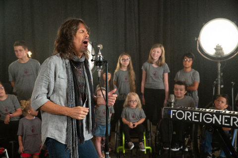 Foreigner with patients of Shriners Hospitals for Children (Photo: Business Wire)