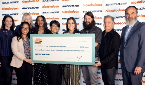 Skechers Foundation president Michael Greenberg (second from right) and executive director Robin Curren (third from left) present Skechers Pier to Pier Friendship Walk donations to the Friendship Foundation. Check recipients included executive director Rabbi Yossi Mintz (far right) and managing director Nina Patel (center). (Photo: Business Wire)