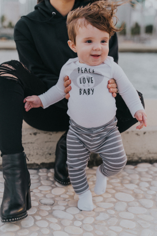 The Hanes Ultimate Baby line was developed using HanesBrands' Innovate to Elevate process, and offers 60 styles of babywear, in knits and fleece, including bodysuits, hoodies, crews, polos, joggers, socks and diaper covers. Photo courtesy of Daniela Ramirez (@Nany)