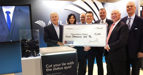 Chris Grady (second from right), Executive Vice President of Retail Sales at Athene, stands with his team and BISA leadership members with check donation for Operation HOPE. (Photo: Business Wire)