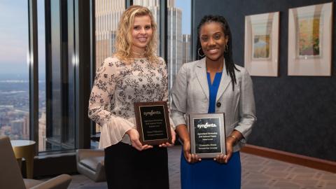Sierra Williamson, left, 2018 bachelor's level national scholarship recipient, and Uzoamaka Abana, 2018 master's level national scholarship recipient, accept their Syngenta Agricultural Scholarship awards. (Photo: Syngenta)