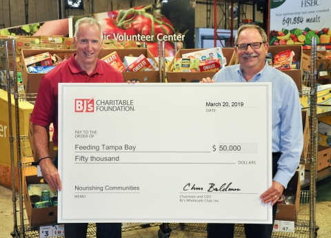 Ron Briggs, General Manager, BJ's Wholesale Club in Clearwater presents a $50,000 donation from the BJ's Charitable Foundation to Thomas Mantz, Executive Director, Feeding Tampa Bay. (Photo: Business Wire)