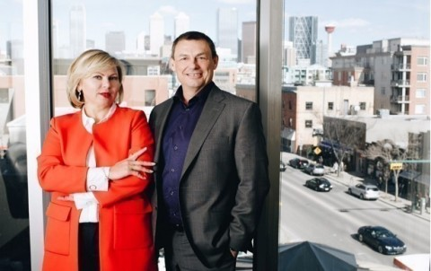 Larisa Wells and Rick Couronne at their office in Calgary (Photo: Business Wire)