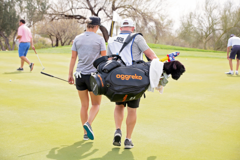 "LPGA golfer Melissa Reid and her caddy Mark Wallington take branded equipment bag gifted from newest sponsor, Aggreko plc, to the green for the first time at the Wildfire Golf Club at JW Marriott Phoenix Desert Ridge Resort and Spa ahead of the Bank of Hope Founders Cup. ""We welcome Mel into the Aggreko family, and look forward to sharing many successes over the next year. Aggreko believes that the values and approach that Mel brings to both life and golf are a great example for all and closely align with our core values,"" said Robert Wells, Managing Director of Aggreko Events Services. (Photo: Business Wire)"