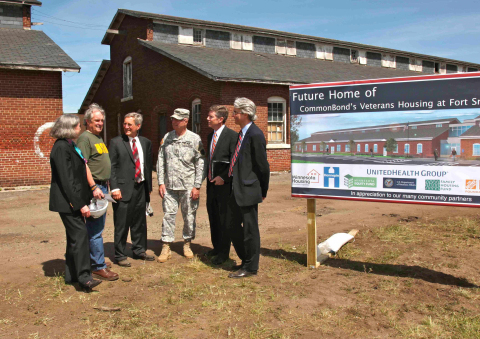 Former homeless Vietnam veteran Jerry Readmond (second from left), an advocate for homeless veterans, shares his story during a groundbreaking ceremony for CommonBond's Veterans Housing at Fort Snelling, which opened in 2015.  UnitedHealthcare was the largest investor in the new community, part of more than $400 million the company has invested to build new affordable housing communities throughout the country since 2011.  L to R: Minnesota Housing Commissioner Mary Tingerthal; Readmond; Paul Fate, president & CEO, CommonBond Communities; Major General Rick Nash, Adjutant General, Minnesota National Guard; Tom McGlinch, vice president, investment management, UnitedHealth Group; and Warren Hanson, president and CEO of Minnesota Equity Fund (Photo: Greg Page, May 2014).