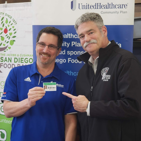 Kevin Kandalaft, CEO of UnitedHealthcare Community Plan of California, and James Floros, CEO of the San Diego Food Bank, introduce the new FEED ID card made possible by a $375,000 grant from UnitedHealthcare to help address food insecurity, modernize the food bank's database systems and connect San Diegans countywide to vital community services (Photo courtesy of UnitedHealthcare).
