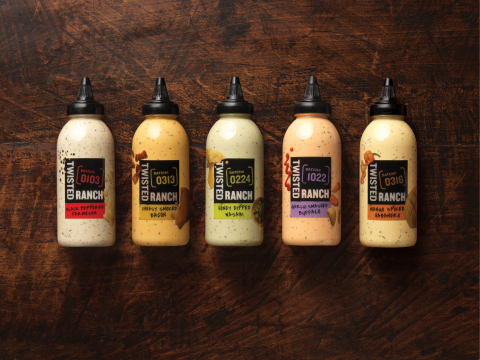 Twisted Ranch is available in five bold flavor varieties: Black Pepper Parmesan, Cheesy Smoked Bacon, Honey Dipped Wasabi, Garlic Smashed Buffalo and Mango Spiked Habanero. (Photo: Business Wire)