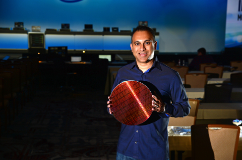 Navin Shenoy, Intel executive vice president and general manager of the Data Center Group, displays  ...