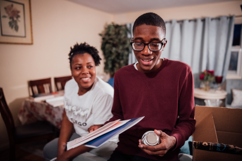Amazon Future Engineer scholarship recipient Leo Jean Baptiste and his mom in Orange, New Jersey. (Photo: Business Wire)