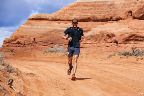 Jonathan Van Dyke running 50K ultramarathon, Behind the Rocks, in Moab, Utah. Photo courtesy of AKTIVA Sport Photography.