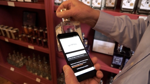 A new way to ensure brand protection: tap phone to tag on luxury item (Photo: Business Wire)