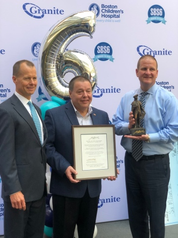 "Thomas P. Koch, Mayor of the City of Quincy, Mass., (center) presents the Maquette of John Hancock to Granite COO Rand Currier (left) and Granite CEO Rob Hale (right) during Granite's 6th Annual ""Saving by Shaving"" event on April 3, 2019. (Photo: Business Wire)"
