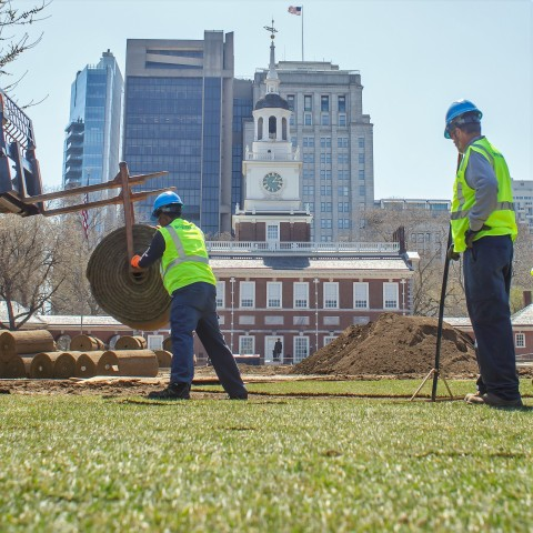 BrightView team members install sod in the mall adjacent to Philadelphia's historic Independence Hal ...