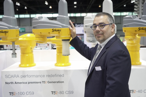 Sebastien Schmitt, Robotics Division Manager, Stäubli North America, showcases the company's new TS2 robots, which feature a modular design and incorporate Stäubli's proprietary JCS drive technology. (Photo: Business Wire)