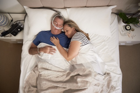 AirFit P30i nasal pillows tube-up CPAP mask, man sleeping, top view (Photo: Business Wire)