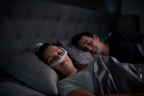 AirFit P30i nasal pillows tube-up CPAP mask, woman sleeping (Photo: Business Wire)