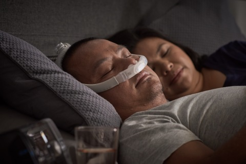AirFit P30i nasal pillows tube-up CPAP mask, man sleeping, close up (Photo: Business Wire)