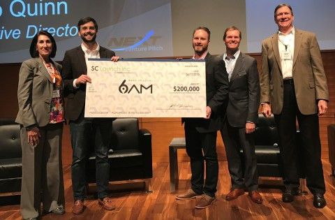 6AM is presented with a big check at NEXT Venture Pitch in Greenville, SC, to celebrate the SC Launc ...