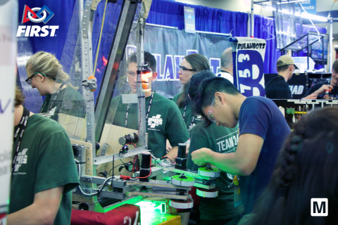 Team members fine tune their robot at the 2018 FIRST Robotics Championship in Houston. (Photo: Business Wire)
