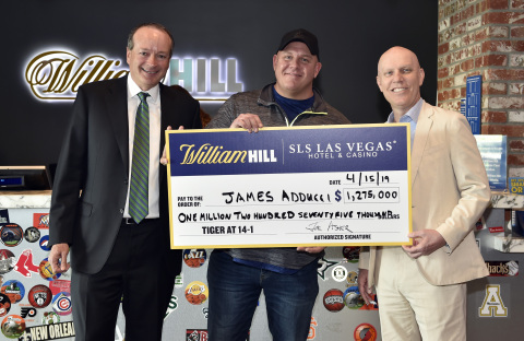 (L-R): William Hill US CEO Joe Asher, James Adducci and SLS Las Vegas general manager Paul Hobson stand with an ceremonial check of Adducci's winnings after cashing his winning ticket at the William Hill Sports Book at SLS Las Vegas Hotel on April 15, 2019 in Las Vegas, Nevada. (Photo: Business Wire)