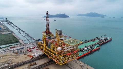 The central platform for CNOOC's Dongfang 13-2 Gas Fields Development Project is loaded onto a barge ...