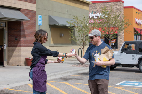 Functional Remedies handing out full-spectrum hemp oil to Carl's Jr customers who bought the CBD-infused Rocky Mountain High burger on 4/20 (Photo: Business Wire)