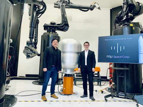 mu Space CEO & Founder James Yenbamroong and Relativity Space CEO & Founder Tim Ellis stand in front of Relativity's Stargate, the world's largest metal 3D printer. (Photo: Business Wire)