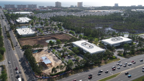 Beckrich Office Park in Panama City Beach, Florida. Land has been cleared for a third office building and progress continues on a new Starbucks building.(Photo: Business Wire)