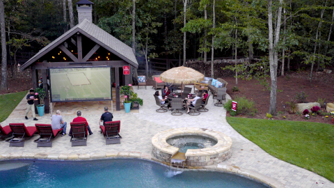 Position the projector screen on the outer perimeter of the gathering space to maximize guest viewing area. Be sure projector placement doesn't impede foot traffic. (Photo: Exmark)