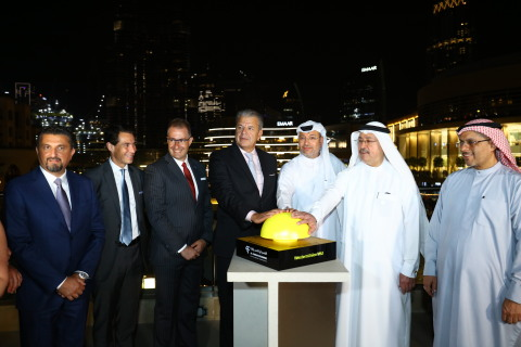 Western Union President and Global CEO Hikmet Ersek joins Osama Al Rahma, CEO, Al Fardan Exchange to trigger the Western Union light show on the iconic Burj Khalifa, launching Western Union digital services in the UAE. He is joined by Western Union and Al Fardan executives. (Photo: Business Wire)