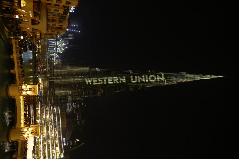 Iconic Burj Khalifa lights up with Western Union colors, a first for a financial services firm. (Photo: Business Wire)