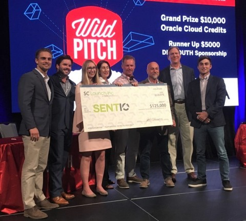 Representatives from SCRA present a big check to SENTIO at DigSouth's Wild Pitch Event on Friday, Ap ...