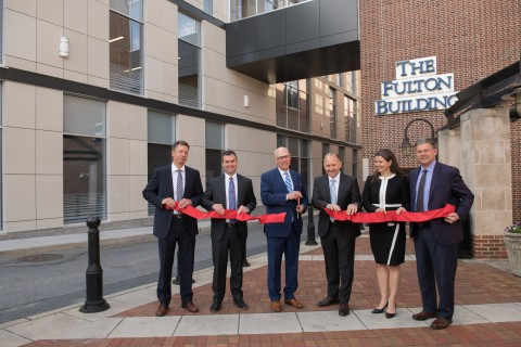 Phil Wenger, Chairman and CEO of Fulton Financial Corporation, cuts the ribbon to commemorate the official opening of Fulton's Headquarters Expansion in downtown Lancaster, PA. (Photo: Business Wire)