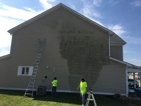Corvias maintenance technicians power washing an on-base home at Aberdeen Proving Grounds, MD. Power ...