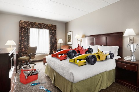 After a pit stop on a comfy bed - like this one at the Hampton Inn - you'll wake feeling tuned-up. (Photo: Business Wire)