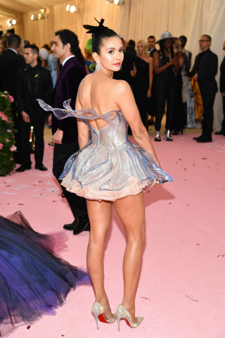 Nina Dobrev's custom Zac Posen x GE Additive x Protolabs bustier is a clear 3D printed dress, which were sanded and sprayed with a clear coat to give it a glass appearance. (Photo: Getty Images)