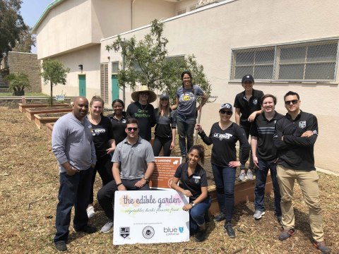 LA Kings team up with Enrich LA to build and refurbish organic gardens throughout schools and community organizations in Los Angeles as part of LA Kings Green, the team's sustainability program which aims to bring awareness to the most critical environmental issues and drive positive impact through arena operations as well as fan and community engagement. (Photo: Business Wire)