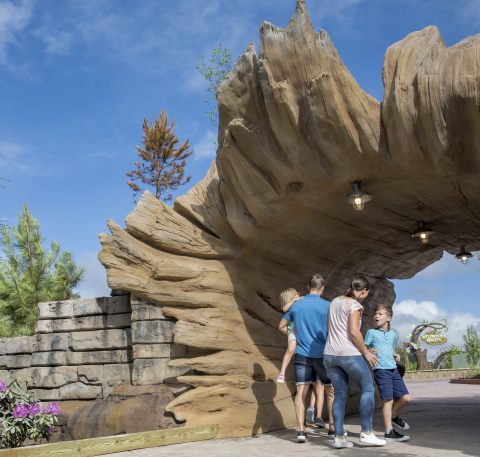 Guests on their way to adventure and exploration enter Dollywood's new Wildwood Grove through a giant fallen log. At $37 million, Wildwood Grove is the largest capital investment in Dollywood's history. (Photo: Business Wire)